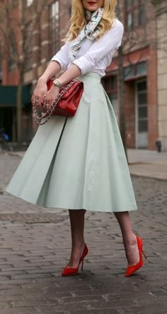 Using heels and a handbag to add a splash of color. White collared shirt with mint skirt paired with beautiful scarf, Bright Red bag & stiletto pumps.