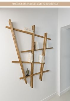 I love this contemporary take on a floating bookshelf. It's hard to believe but the entire bookshelf is completely screwless! Simple timber studs and good old 'no more nails' is...Make It: Screwless Floating Bookshelf (also think this might make a great picture rail)