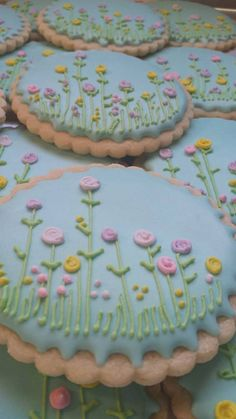 ONE DOZEN Sugar cookies decorated with tiny flowers. Perfect for Mothers Day or spring gifting. Each cookie is wrapped in a cello bag and tied