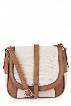 We have given the classic saddle bag a gorgeous neutral colour combination - so it willl go with pretty much everything. Comes with an internal zip pocket and adjustable strap.