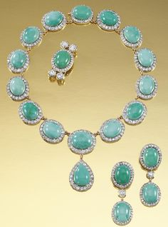 TURQUOISE AND DIAMOND PARURE, LATE 19TH CENTURY.  The necklace designed as a series of clusters, each centring on an oval cabochon turquoise within surrounds of circular-cut diamonds, suspending at the front a similarly designed pear-shaped drop, together with a pair of ear pendants and a brooch en suite