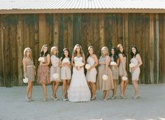 Bridesmaids dresses, all different, short nude and sexy. Gold shoes with white bouquets! Scottsdale Country Glam Barn Wedding