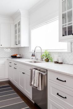 New & Fresh Interior Design Ideas for your Home Shaker Kitchen Cabinets with simple herringbone subway tile and white marble countertop. Shaker style cabinets are painted in Benjamin Moore Decorator's White Chango & Co. Shaker Style Kitchen Cabinets, Shaker Style Kitchens, Kitchen Cabinet Styles, Home Kitchens, Updated Kitchen, New Kitchen, Kitchen Decor, Maple Kitchen, Awesome Kitchen