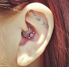 Double Daith piercing (w/ anatometal Captive bead ring and Unbreakable seam ring) along with a faux industrial (hybrid project of Industrial Strength and Body Vision Los Angeles). Both done by Garrett at B'z Ink Tattoo Shop in Troy, Michigan.