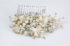 This wedding hair comb is perfect for Fall or any garden theme wedding. Freshwater ivory pearls, round and teardrop glass jewels sparkle in-between matte gold