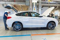 Production of the 2015 BMW X4 kicked off on Friday in South Carolina. The BMW X family is growing with the addition of the new BMW X7 SUV, which will be built in the U.S. for world markets.