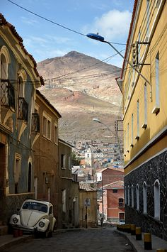 Cerro Rico looming above the city of Potosi, Bolivia ~ UNESCO World Heritage Site, a silver mining town founded in 1545 that was one of the world's largest 16th century industrial complexes