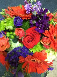 Wedding bouquet orange roses, purple stock , green hydrangea, hypericum berry and mini green hydrangea