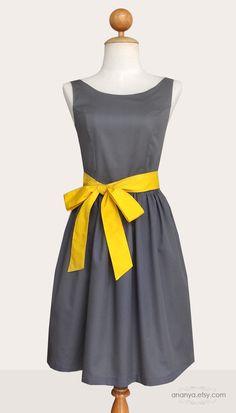 Black dress yellow sash.
