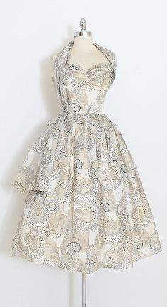 ➳ vintage 1950s dress * gorgeous delicate tissue think silk * acetate and tulle lining * amazing metallic polka dot paisley print * attached versatile shoulder sash * metal back zipper condition | excellent - one tiny repair in skirt fits like xs length 42 bodice 11 bust 32-33 waist 24-25 ➳ shop http://www.etsy.com/shop/millstreetvintage?ref=si_shop ➳ shop policies http://www.etsy.com/shop/millstreetvintage/policy twitter | MillStVintage...