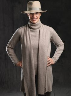 Sweater set in Moondust color with coffee herringbone trousers and Barbisio stone color soft fur felt hat.