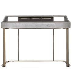 Yves Baxter Desk Yves designed by Roberto Lazzeroni for Baxter is a beautiful desk with base in satin brass-coated metal, in hand-finished burnished metal or in satin nickeled metal, with matte varnish. MDF frame with leather upholstery.