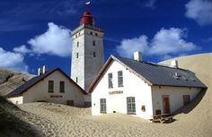 Rubjerg Knude Lighthouse in Jutland Denmark started life on December 27, 1900 (construction started in 1899). The lighthouse is 60 metres above sea level. Until 1908 it operated on gas.  It ceased to operate on August 1, 1968.