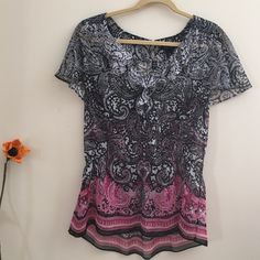 White House Black Market Top Black, white and pink colors. Sheer like material and two buttons on the back,Excellent condition White House Black Market Tops Tunics
