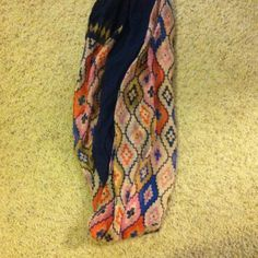 Set of Two infinity scarves One dark blue, the other an Aztec print in pink, blue, orange, gold and beige colors. Lightweight, and very complimentary together. Perfect addition to an upcoming spring wardrobe. Accessories