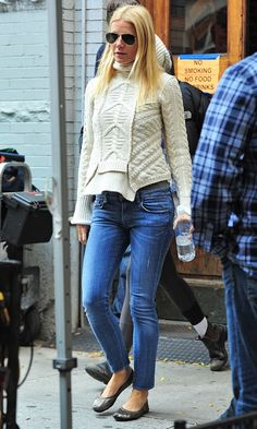 Gwyneth Paltrow gives her cable knit an A-list twist with aviators and rich blue jeans.