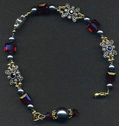 Bracelet for the Matron of Honor. The little dangle at the end comes off to wear as a charm on other things if desired. It also helps balance the bracelet while it's being worn, so that the clasp doesn't ride up to the top of the wrist where it's easily seen.