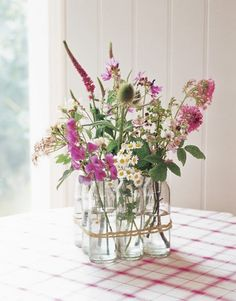 Pretty informal centerpiece idea, do in group of three instead if six for dining tables.