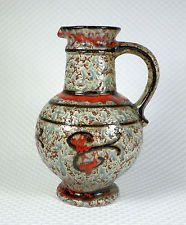 Uebelacker U-Keramik 1809/25. Gift from my Mum. She paid $25. It came with a matching bowl 335/20. Gorgeous glaze.