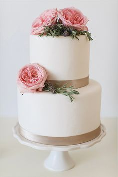 white wedding cake with pink roses @weddingchicks