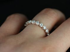 Haylie14kt Rose Gold Swooped Bubble & Dot Moissanite Halfway Eternity Band (Other Metals and Stone Options Available). $650.00, via Etsy.