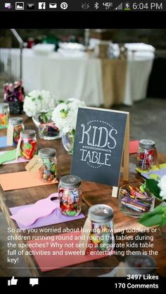 Kids table. Love this   Put the coloring pages, crayons, maybe photo scavenger hunt papers on it!