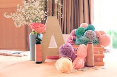Lalaloopsy Themed Birthday Party : One Charming Day  DIY yarn balls, spools, letter cardboard and fresh flowers for the centerpiece.