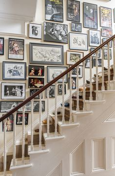 stairway gallery wall ... colourful collection of posters, drawings and photos from an English actor's career unified by plain narrow frames in black or silver, white or grey mattes