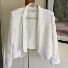 ✨Club Monaco off white blazer size 4 Club Monaco off white blazer size 4. Worn once! Excellent condition, practically brand new! Fun and very pretty ribbing pattern. Perfect blazer for Spring! 🌷💕 I love this blazer, just a tad too small for me as I'm a true size 6. Loved it so much I bought it anyway! [15% off bundles] 💝😍 Club Monaco Jackets & Coats Blazers