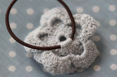Crochet hair tie back, my daughter needs these :)