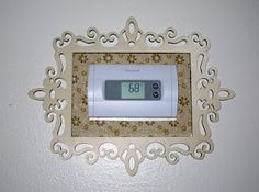 More than cosmetic - it hides the mark left behind from the old thermostat.