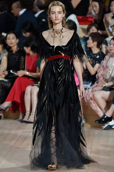 "Valentino Fall 2015.Rome is a beating heart of Valentino brand . An EAGLE, symbol of Imperial Rome,clutched a red ribbon in its beak on the ""opening gawn""of the runway was the same bird that constractors found on the ceilling of the house´s Roman atelier during its recent renovation.Beautifull metaphor indeed :)"