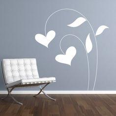 """Fiorellino. Un romantico fiore a forma di cuore. Adesivo murale di alta qualità con pellicola opaca di facile installazione. Lo sticker si può applicare su qualsiasi superficie liscia: muro, vetro, legno e plastica. L'adesivo murale """"Fiorellino"""" è ideale per decorare il soggiorno."""