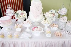 Beautiful dessert table with pastels and lace accents.