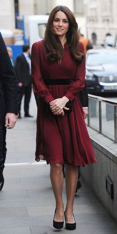 JANUARY 11, 2013 The Duchess of Cambridge wore a burgundy Whistles dress to attend the unveiling of her official portrait at the National Portrait Gallery in London.