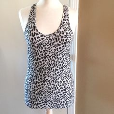 VS Pink cheetah Tank! Victorias Secrete cheetah print tank! Excellent condition! The tag is listed as sleepwear, could be used as a normal top too! PINK Victoria's Secret Tops Tank Tops