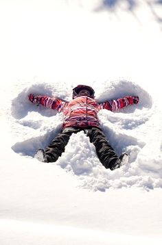 Kid making angel in snow...
