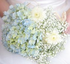 Hydrangea Blues and Ivory white Daisies  Hydrangea and daisies are two popular summer blooms that come in many shades to coordinate with any wedding palette. Pale blue and white flowers are a fresh, sweet option for a morning or early summer wedding, while bolder, stronger colors are more suitable for afternoon weddings deeper in the season.