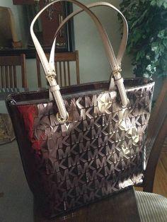 Metallic MK purse.