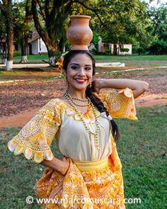 A girl wearing a Ñandutí dress during a folk dance, Santa María de Fe, Paraguay © Marco Muscarà