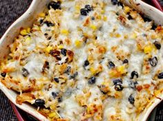 Healthy Cheesy chicken and rice bake with black beans and corn.  Delicious!!