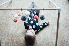 DIY wooden baby gym - use dowel poles and plumbing or other connectors to join gym together. So much nicer and more stable than plastic ones