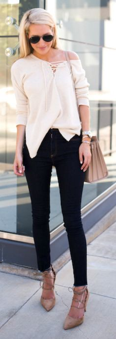 Krystal Schlegel + sleek and sophisticated + fall outfit + string front top + skinny denim jeans + simple yet effective style + strappy heels + Krystal's look!   Heels: Sam Edelman, Sweater: Nordstrom, Jeans: Rag and Bone, Bag: Saint Laurent.