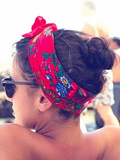 Wrap a scarf around your head so that the two ends meet at the top of your head, and tie in a bow. Secure with hairpins if the scarf feels loose around your head.