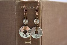 Using a book to photograph earrings.  (Link no longer works, but I still pinned.)