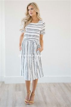The Lexie puts a twist on your typical striped dress! This cute summer dress features crayon like stripes, short sleeves, a gathered waist and cute waist tie sash. Lined.
