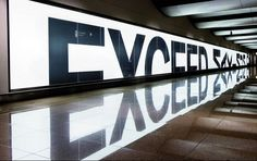"""BMW commissioned Serviceplan to design a billboard for the Hamburg airport. illuminated billboard with letters half cut; the natural reflection of the sign on the shiny floor would now spell """"Exceed Maximum. Environmental Graphic Design, Environmental Graphics, Wayfinding Signage, Signage Design, Typographie Inspiration, Mirror Effect, Mirror Text, Mirror Mirror, Design Graphique"""