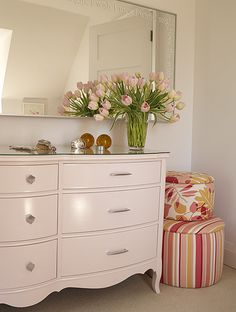 The more I look at this, the more I love the light pink French Provencial style dresser with a more modern drawer pull.