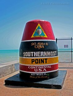 https://flic.kr/p/6Bf9Lj | Key West! | These pictures were from our trip to Key West yesterday. I only took pictures at this southernmost point marker, though I should've gotten some shots of Duval Street. Shannon and I got hit on by a 24 year old guy named Matt, talked to by some random dumb kid from Orlando, and approached by some homeless 20-something-year-olds, a girl and a guy, who made roses out of palm tree leaves. I gave them 3 bucks, which they quickly spent at the liquor store. Oh…