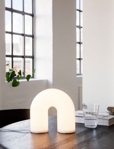 Ferm Living White Vuelta Arch Lamp We love the unique rainbow shape of this gorgeous lamp! The on-trend arch shape is reminiscent of ancient columns, adding a subtle trend-led piece to your home. The lamp is made from opal glass with a striking rippled su Reeded Glass, Boho Lighting, Arch Lamp, Design Light, Diffused Light, Home Living, Living Room, Light Table, White Table Lamp